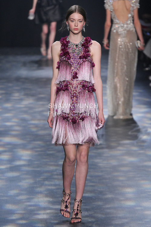 Model Lauren walks runway in an Anethyst to lilac ombré fringe cocktail with laser-cut flowers and amethyst floral beading, from the Marchesa Fall 2016 collection by Georgina Chapman and Keren Craig, presented at NYFW: The Shows Fall 2016, during New York Fashion Week Fall 2016.