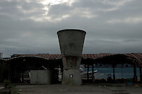 A landscape view of a damaged building at Miyako Bay during reconstruction efforts following the 311 Tohoku Tsunami in Miyako, Japan  © LAN