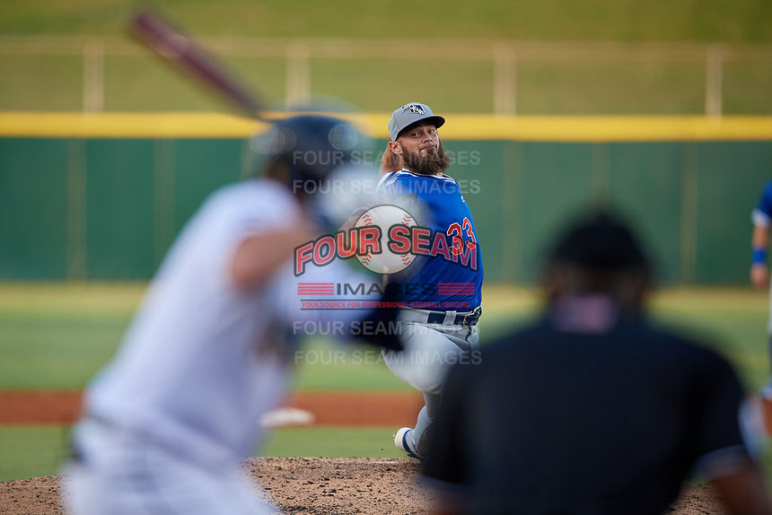 Oklahoma City Dodgers starting pitcher Ben Holmes (33) delivers a pitch to batter Austin Dean during a Pacific Coast League game against the New Orleans Baby Cakes on May 6, 2019 at Shrine on Airline in New Orleans, Louisiana.  New Orleans defeated Oklahoma City 4-0.  (Mike Janes/Four Seam Images)