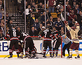 Pat Mullane (BC - 11) celebrates Johnny Gaudreau's (BC - 13) goal. - The Boston College Eagles defeated the Northeastern University Huskies 6-3 for their fourth consecutive Beanpot championship on Monday, February 11, 2013, at TD Garden in Boston, Massachusetts.