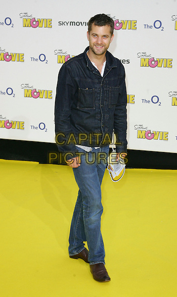 "JOSHUA JACKSON.The Simpsons Movie"" UK premiere at the Vue O2 Arena cinema, London, England. .July 25th, 2007.full length jeans denim jeans denim jacket blue.CAP/ROS.©Steve Ross/Capital Pictures"