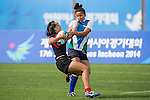 Singapore plays Uzbekistan during the17th Asian Games 2014 Rugby Womens Sevens tournament on October 01, 2014 at the Namdong Asiad Rugby Field in Incheon, South Korea. Photo by Alan Siu / Power Sport Images