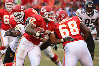 Chiefs running back Larry Johnson uses his blocker Will Shields to pick up some yards during the first half against the Jacksonville Jaguars at Arrowhead Stadium in Kansas City, Missouri on December 31, 2006. The Chiefs won 35-30.