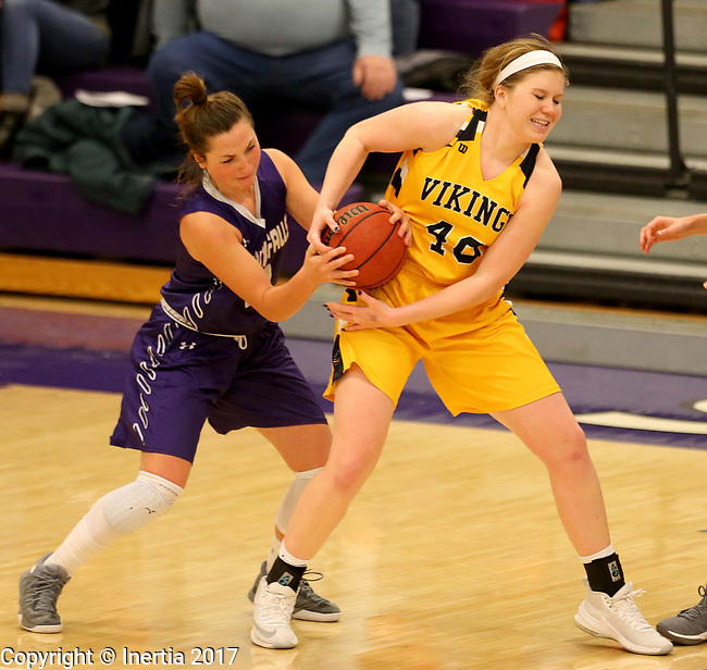 SIOUX FALLS, SD - DECEMBER 31: Augusta Thramer #3 from the University of Sioux Falls ties up Shelby Selland #40 from Augustana University during their game Sunday afternoon December 31, 2017 at the Stewart Center in Sioux Falls. (Photo by Dave Eggen/Inertia)