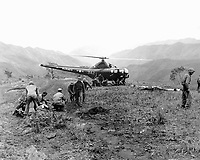 U.S. Marines wounded at Kari San Mountain are evacuated via helicopter and flown to hospital in near areas for treatment.  Navy Corpsmen prepare three wounded Marines for evacuation.  May 23, 1951.  N.H. McMasters.  (Navy)<br /> NARA FILE #  080-G-429571<br /> WAR & CONFLICT BOOK #:  1453