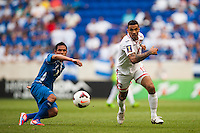 Trinidad and Tobago defender Carlos Edwards (11) gets past El Salvador midfielder Osael Romero (8) during a CONCACAF Gold Cup group B match at Red Bull Arena in Harrison, NJ, on July 8, 2013.