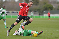 Ricky Brennan Of Waltham Abbey slides in on Liam Ferdinand of Bracknell Town during Waltham Abbey vs Bracknell Town, Bostik League South Central Division Football at Capershotts on 9th February 2019