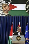 Austrian Chancellor Werner Faymann and Palestinian President Mahmoud Abbas (not seen) hold a joint news conference in the West Bank city of Ramallah on June 24, 2010. Photo by Eyad Jadallah