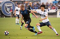 SAN JOSE, CA - AUGUST 24: Jackson Yueill #14 of the San Jose Earthquakes and Inbeom Hwang #4 of the Vancouver Whitecaps during a game between Vancouver Whitecaps FC and San Jose Earthquakes at Avaya Stadium on August 24, 2019 in San Jose, California.