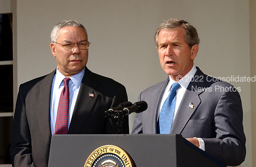 United States President George W. Bush speaks in the Rose Garden at the White House on March 14, 2003 in Washington as US Secretary of State Colin Powell looks on.  Bush announced that he will unveil an additional plan for peace between Israelis and Palestinians, but that the new Palestinian PM would have to make considerable strides towards peace and the Israelis would have to stop the expansion of settlements.    <br /> Credit: Ron Sachs / CNP