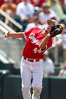 Houston Cougars third baseman Connor Hollis (44) catches a infield pop up during the NCAA baseball game against the Texas Longhorns on June 6, 2014 at UFCU Disch–Falk Field in Austin, Texas. The Longhorns defeated the Cougars 4-2 in Game 1 of the NCAA Super Regional. (Andrew Woolley/Four Seam Images)