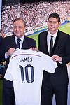 Colombian player, James Rodriguez (R), poses with Real Madrid´s President Florentino Perez during his official presentation as a new Real Madrid player at the Santiago Bernabeu stadium in Madrid, Spain. July 22, 2013. (ALTERPHOTOS/Victor Blanco)