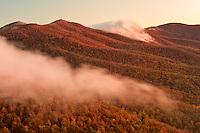 Autumn Colors and mist at sunrise, Blue Ridge Mountains from Blue Ridge Parkway at sunrise, North Carolina