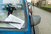 Parking ticket on the windscreen of a car in London