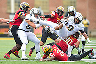 College Park, MD - OCT 1, 2016: Purdue Boilermakers running back Markell Jones (8) is hit by Maryland Terrapins defensive lineman Roman Braglio (90) and goes airborn during game between Maryland and Purdue at Capital One Field at Maryland Stadium in College Park, MD. The Terps got the win 50-7 over visiting Purdue. (Photo by Phil Peters/Media Images International)