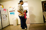 Dennis Sawyer plays with his daughter Frances January 27, 2010 at their home in Sacramento, Calif. The Sawyer family receives $540/month in CalWORKs assistance from the state of California. Dennis is currently unable to work while recovering from cancer, and Sophia hasn't been able to find work. Gov. Arnold Schwarzenegger has proposed eliminating the CalWORKs program in an effort to balance the state's budget. CREDIT: Max Whittaker for The Wall Street Journal.CABUDGET
