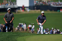 Francesco Molinari (ITA) and Tyrrell Hatton (ENG) on the 18th green during the 3rd round at the PGA Championship 2019, Beth Page Black, New York, USA. 19/05/2019.<br /> Picture Fran Caffrey / Golffile.ie<br /> <br /> All photo usage must carry mandatory copyright credit (© Golffile | Fran Caffrey)