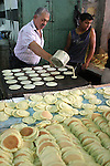 Palestinian vendors prepare qatayef, a pancake-like shell which is filled with nuts or sweet cheese, fried in oil or baked then dipped in sugar syrup, a popular sweet during Ramadan, in a shop in the West Bank city of Hebron on Aug. 9, 2011. Muslims around the world are observing the holy fasting month of Ramadan where they refrain from eating, drinking, smoking and sex from dawn to dusk. Photo by Najeh Hashlamoun