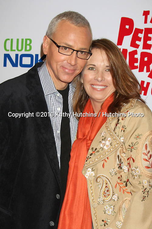 "Drew Pinsky & wife.arriving at the ""The Pee Wee Herman Show"" Opening Night..Club Nokia.Los Angeles, CA.January 20, 2010.©2010 Kathy Hutchins / Hutchins Photo...."