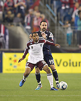 Colorado Rapids midfielder Ross LaBauex (16) attempts to control the ball as New England Revolution defender Ryan Cochrane (45) pressures. In a Major League Soccer (MLS) match, the New England Revolution tied the Colorado Rapids, 0-0, at Gillette Stadium on May 7, 2011.