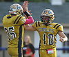 Frank Ragusa #10, right, and Liam Colwell #35 of Bethpage react after their team moves the chains on a fourth down in the fourth quarter of a Nassau County Conference III varsity football game against Plainedge at Bethpage High School on Saturday, Oct. 21, 2017. Bethpage won by a score of 28-21.