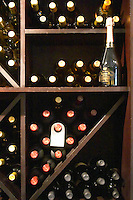 Bottles on shelves in the wine shop and a standing bottle of sparkling Baron B Cuvee Speciale Extra Brut. The O'Farrell Restaurant, Acassuso, Buenos Aires Argentina, South America