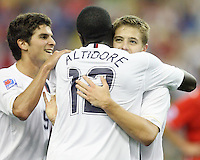 Nathan Sturgis and Robbie Rogers congratulate Josmer Altidore after his goal. USA polished off Poland 6-1 behind a Freddy Adu hat trick  in the second game in group D of the FIFA U-20 World Cup at the Parc Olympique in Montreal on July 3 2007.