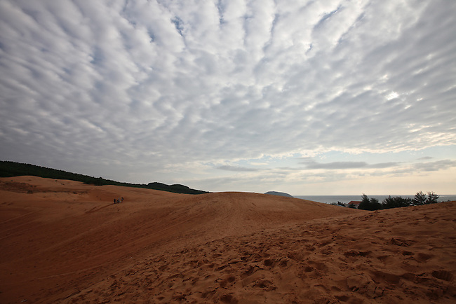 Clouds stretch like a wrinkled blanket over the red dunes near Mui Ne, Vietnam. Nov. 11, 2011.