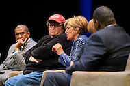 January 12, 2012  (Washington, DC)  Radio and television talk show host Tavis Smiley (left) moderated a panel discussion on restoring America's prosperity at the George Washington University Lisner Auditorium in Washington. (L-R) Michael Moore, Suze Orman, Vicki Escarra (not pictured), Roger Clay, Jr.  (Photo by Don Baxter/Media Images International)