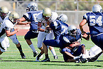 Torrance, CA 09/08/11 - unidentified North player and Marco Catallo (Peninsula #10) in action during the North-Peninsula Junior Varsity Football game at North High School in Torrance.