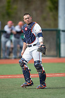 Matt Thaiss (21) of the Virginia Cavaliers on defense against the Hartford Hawks at The Ripken Experience on February 27, 2015 in Myrtle Beach, South Carolina.  The Cavaliers defeated the Hawks 5-1.  (Brian Westerholt/Four Seam Images)