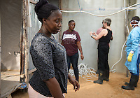 Occidental College professor Mary Beth Heffernan works on her PPE Portrait Project with health care workers at the ELWA II ETU (Ebola treatment unit) in Monrovia, Liberia on Saturday, March 8, 2015. The ETU, operated by ELWA Hospital, was the first to open in Monrovia. Professor Heffernan's project involves creating wearable portraits of health care workers who must wear PPE (personal protective equipment) when working with patients, for example, patients with Ebola. <br /> (Photo by Marc Campos, Occidental College Photographer) Mary Beth Heffernan, professor of art and art history at Occidental College, works in Monrovia the capital of Liberia, Africa in 2015. Professor Heffernan was there to work on her PPE (personal protective equipment) Portrait Project, which helps health care workers and patients fighting the Ebola virus disease in West Africa.<br />