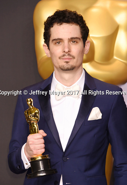 HOLLYWOOD, CA - FEBRUARY 26: Filmmaker Damien Chazelle, winner of the award for Directing for 'La La Land,' poses in the press room during the 89th Annual Academy Awards at Hollywood & Highland Center on February 26, 2017 in Hollywood, California.