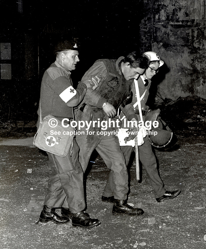 Injured British soldier helped away by Army medic and Order of Malta volunteer during rioting in the Bogside, Londonderry, N Ireland. 196909000356...Copyright Image from Larry Doherty, c/o Victor Patterson, 54 Dorchester Park, Belfast, UK, BT9 6RJ..Tel: +44 28 9066 1296.Mob: +44 7802 353836.Voicemail +44 20 8816 7153.Skype: victorpattersonbelfast.Email: victorpatterson@mac.com.Email: victorpatterson@ireland.com (back-up)..IMPORTANT: If you wish to use this image or any other of my images please go to www.victorpatterson.com and click on the Terms & Conditions. Then contact me by email or phone with the reference number(s) of the image(s) concerned.