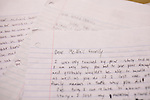 A stack of condolence letters written by students to the McNair Family.