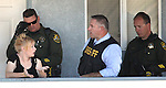 Carson City Sheriff's officials interview Rachel Darlene Barrett, 30, outside a South Carson City apartment Tuesday morning, Oct. 11, 2011. Barrett was later arrested for allegedly robbing a Nevada State Bank in Carson City, NV..Photo by Cathleen Allison