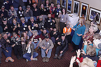 Millenium Alaska Hotel manager Carol Fraser gives a goodwill toast to the entire field of 66 2013 Iditarod mushers  during the mandatory musher meeting at the Millenium hotel two days prior to the start of Iditarod 2013...Photo (C) Jeff Schultz/IditarodPhotos.com  Do not reproduce without permission.