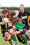 Grant Henson gets tackled by Shawn Stewart. Counties Manukau Premier Club Rugby game between Waiuku and Bombay, played at Waiuku on Saturday July 5th 2010. Waiuku won 59 - 14 after trailing 12 - 14 at halftme.