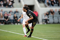 LOS ANGELES, CA - MARCH 01: Carlos Vela #10 of LAFC takes a chip shot scores a goal and celebrates during a game between Inter Miami CF and Los Angeles FC at Banc of California Stadium on March 01, 2020 in Los Angeles, California.