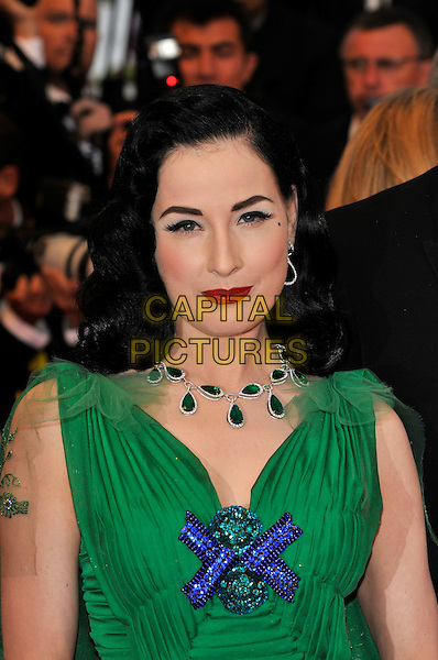 "DITA VON TEESE.""The Exchange"" ( formerly titled ""Changeling"" ) film premiere at Palais de Festival during the 61st Cannes International Film Festival, Cannes, .France, 20th May 2008 .red carpet arrivals portrait headshot green dress blue beaded cross necklace emeralds red lipstick netting.CAP/PL.© Phil Loftus/Capital Pictures"
