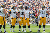The Iowa offensive line awaits the start of the next play. Pictured are Brandon Scherff (68), Sean Welsh (79), Austin Blythe (63), Jordan Walsh (65) and Andrew Donnal (78). Iowa Hawkeyes defeated the Pitt Panthers 24-20 at Heinz Field, Pittsburgh Pennsylvania on September 20, 2014.