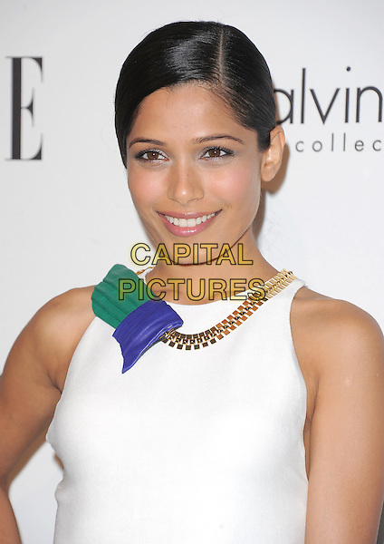 Freida Pinto.18th Annual ELLE Women in Hollywood celebration held at The Four Seasons in Beverly Hills, California, USA..October 17th, 2011.headshot portrait white sleeveless necklace gold purple green.CAP/RKE/DVS.©DVS/RockinExposures/Capital Pictures.