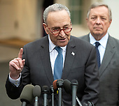 United States Senate Minority Leader Chuck Schumer (Democrat of New York) speaks to reporters at the White House after meeting with US President Donald J. Trump on border security and reopening the federal government at the White House in Washington, DC on Wednesday, January 2, 2018.  Lookin on from the right is US Senator Dick Durbin (Republican of Illinois).<br /> Credit: Ron Sachs / CNP