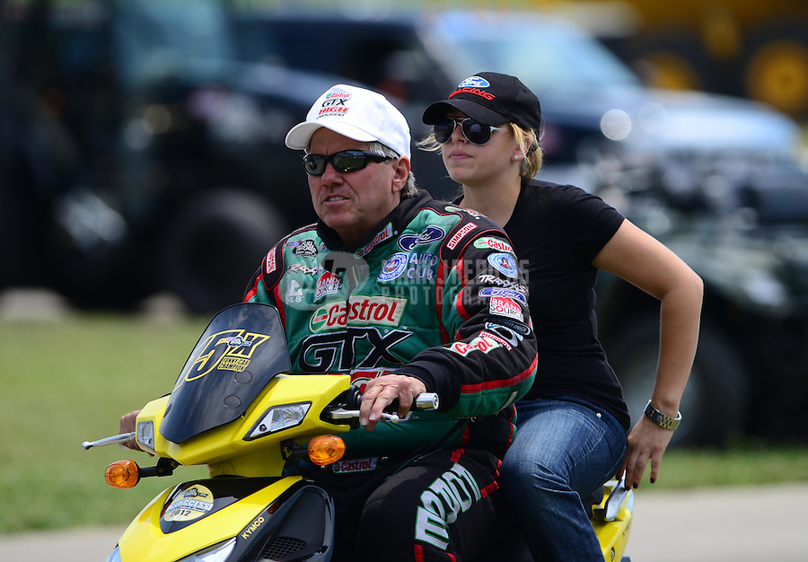 May 19, 2012; Topeka, KS, USA: NHRA funny car driver John Force with daughter Brittany Force during qualifying for the Summer Nationals at Heartland Park Topeka. Mandatory Credit: Mark J. Rebilas-
