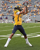 WVU wide receiver Logan Heastie warms up before the game. The WVU Mountaineers defeated the East Carolina Pirates 35-20 at Mountaineer Field at Milan Puskar Stadium, Morgantown, West Virginia on September 12, 2009.