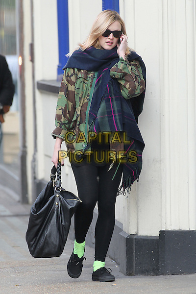 Fearne Cotton.Seen leaving work after her morning radio show, BBC Radio 1 studios, London, England, UK, .23rd November 20212..full length sunglasses pregnant black leggings camouflage jacket green army tartan plaid navy blue scarf black hobo bag talking on mobile phone ankle socks trainers .CAP/HIL.©John Hillcoat/Capital Pictures.