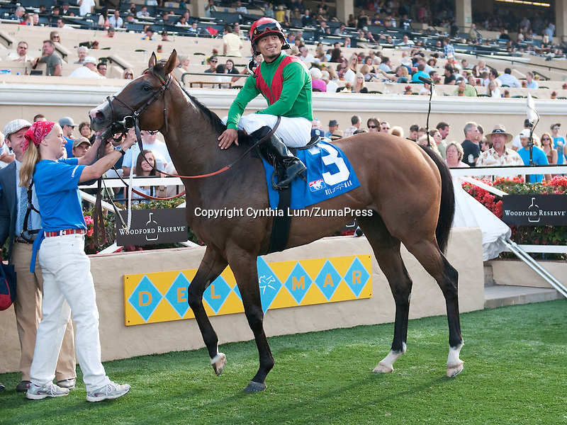 August 20, 2011.Summer Soiree ridden by Gabriel Saez in the winner's circle after winning the Del Mar Oaks to Del Mar Thoroughbred Club, Del Mar, CA..