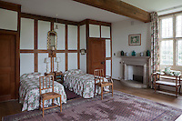 A simply furnished timber framed twin bedroom