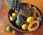 bowl with pineapple, papayas, lemons and figs