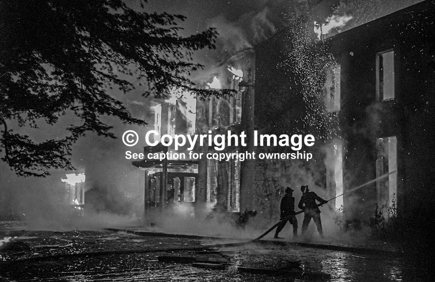 Fireman in action at the scene of the Provisional IRA bombing and subsequent fire at the Woodburn House Hotel on the Stewartstown Road, Belfast, N Ireland, UK, 1971. PLEASE CONTACT ME IF YOU CAN TELL ME EXACT DATE OF INCIDENT. 197100000445e<br />